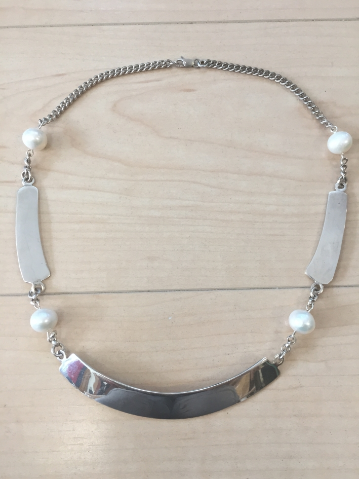 6ca3b8c237f38c Three stunning curved plates of Sterling Silver are accented by Grade A  White Fresh Water Pearls on a Sterling Silver chain with a lobster claw